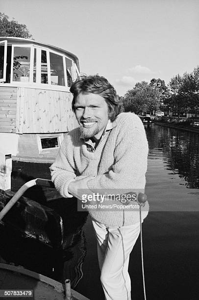 English businessman and owner of Virgin Records Richard Branson posed on his houseboat on the Grand Union canal in London on 26th May 1982
