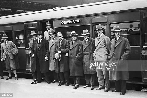 English businessman Samuel Ryder and the British Ryder Cup golf team stand in front of a train in preparation for their trip to America Original...