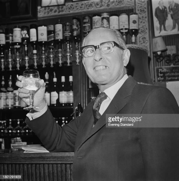 English businessman Sir Basil Smallpeice , a director of mining based conglomerate Lonrho, drinking at a bar in London, UK, 14th May 1973. He and the...