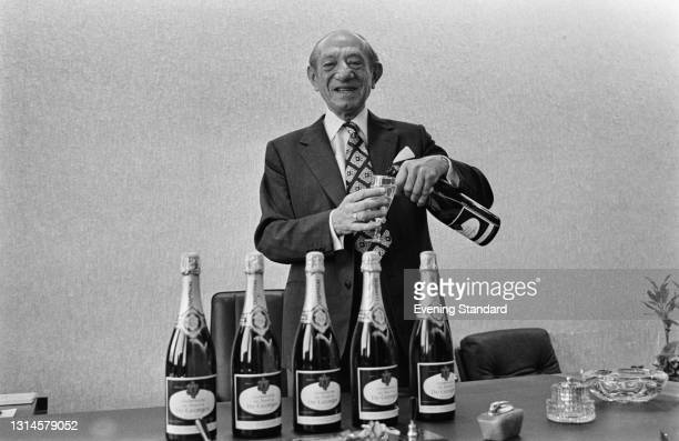 English businessman Sir Jack Cohen , founder of the Tesco supermarket chain, pours a glass of Tesco's own De Georges champagne, UK, 6th December...