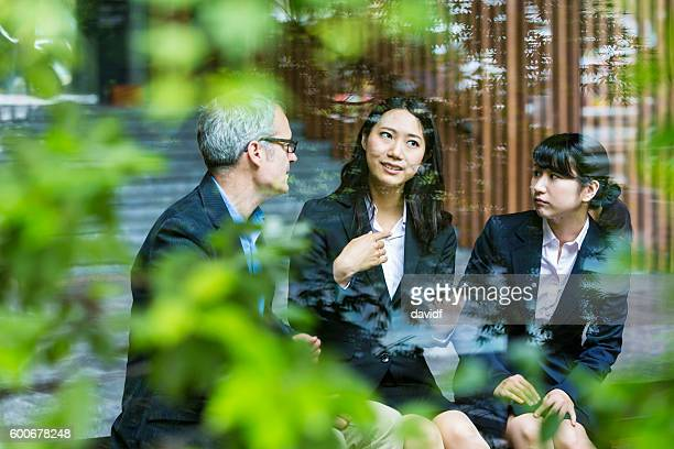 English Businessman Working Advising Japanese Corporate Professional Business Women