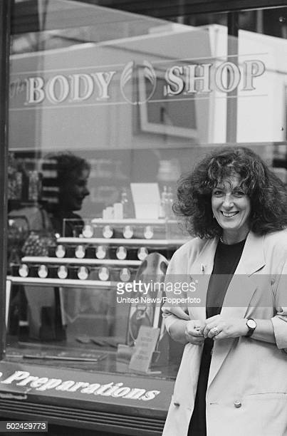 English businesswoman and founder of 'The Body Shop' cosmetics company Anita Roddick stands outside one of her shops on 21st October 1985
