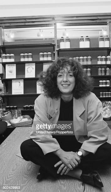 English businesswoman and founder of 'The Body Shop' cosmetics company Anita Roddick sits inside one of her shops on 21st October 1985