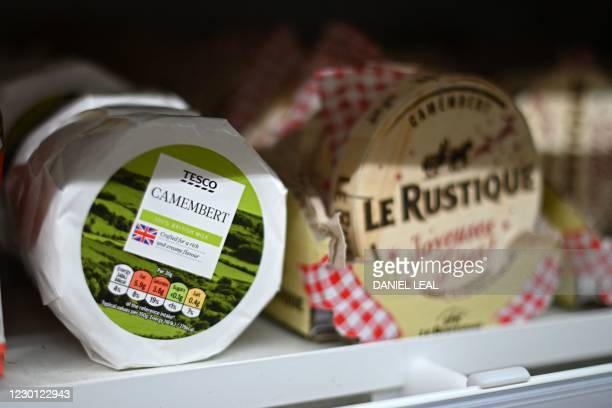 English camembert cheese is sold beside French camembert in a Tesco supermarket in London on December 14, 2020. - With just over two weeks to go...