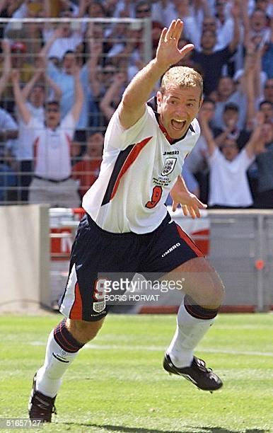 English captain Alan Shearer jubilates after scoring the 1st goal 15 June at the Stade Velodrome in Marseille during the 1998 Soccer World Cup Group...