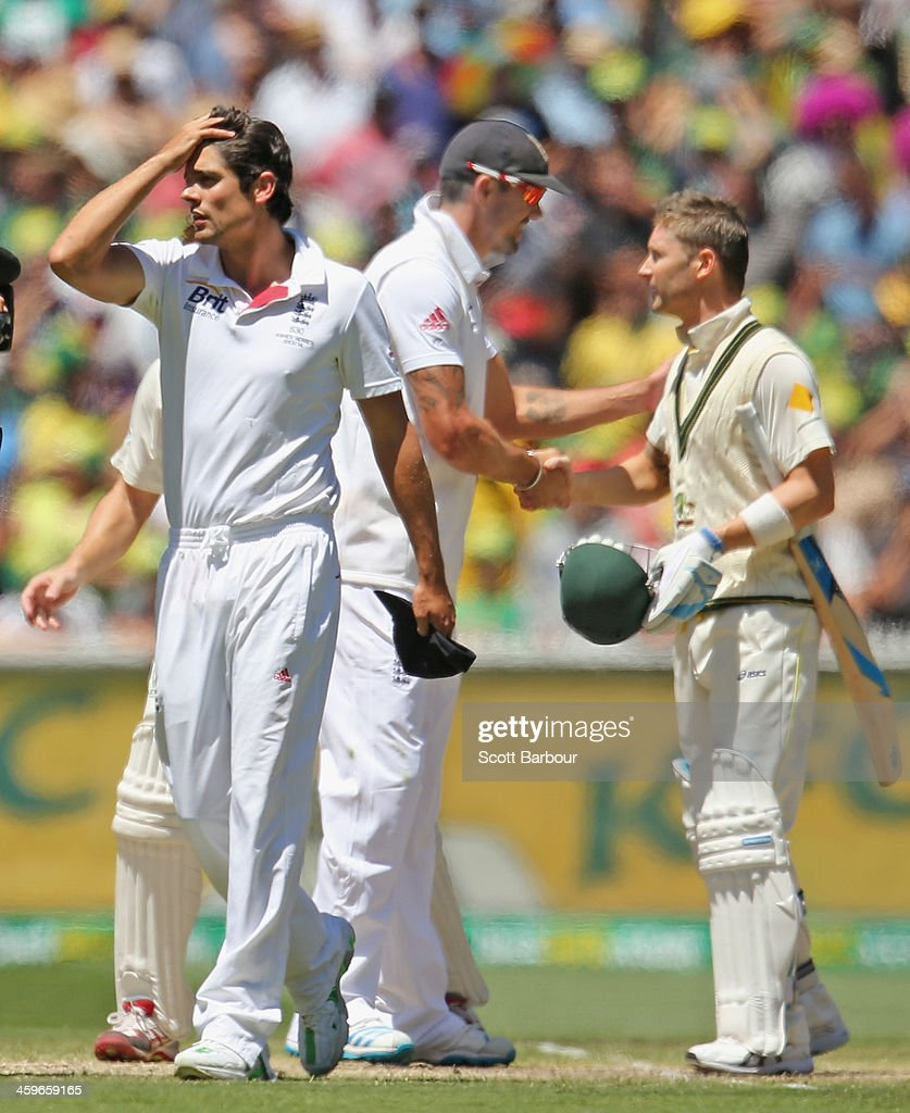English captain Alastair Cook (L) looks dejected as Australian captain Michael Clarke shakes the hand of Kevin Pietersen of England after Australia won the match during day four of the Fourth Ashes Test Match between Australia and England at Melbourne Cricket Ground on December 29, 2013 in Melbourne, Australia.