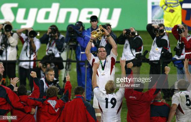 English captain and lock Martin Johnson lifts the William Webb Ellis Cup after winning the Rugby World Cup 2003 final between Australia and England...