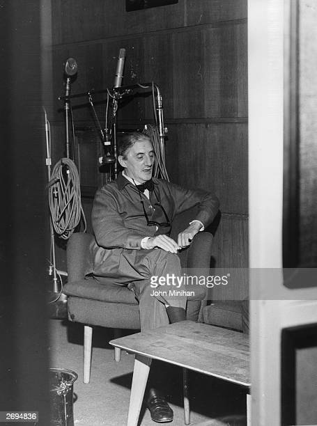 English cellist and conductor, Sir John Barbirolli , relaxes with a cigarette at a recording studio.