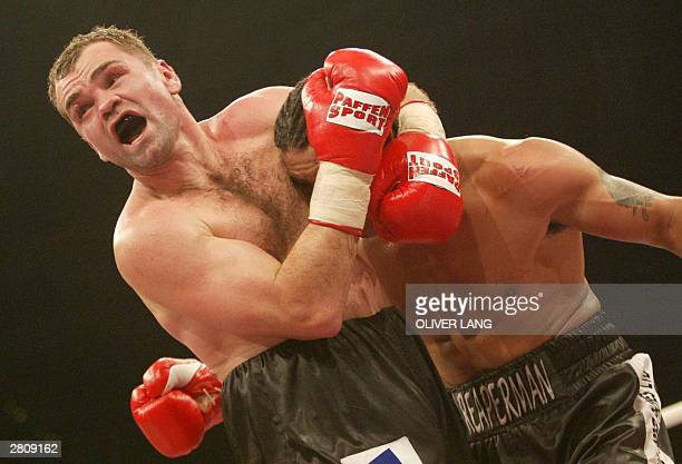 English challenger Robin Reid exchanges punches with German super middleweight IBF and WBA title holder Sven Ottke at Nuernberg Areba 13 December...