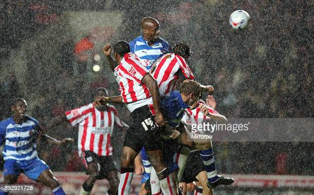 English Championship match at St Mary's Stadium. Southampton 0 v Reading 0. Reading's Eric Obinna leaps high in the driving rain to head the ball...
