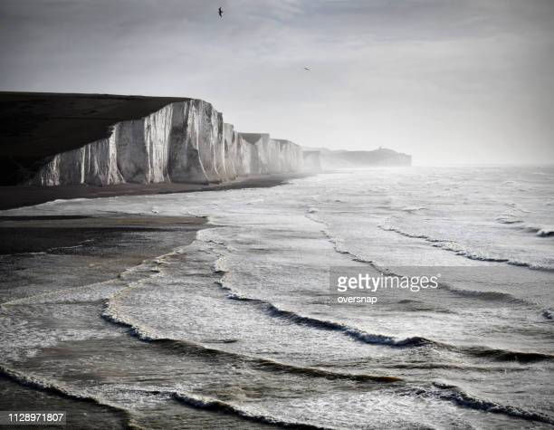 english channel seascape - seven sisters cliffs stock photos and pictures