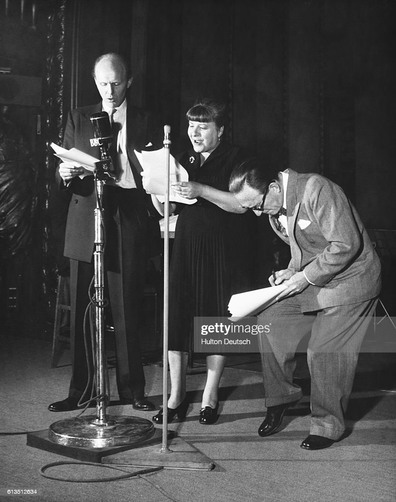 English character actress Irene Handl rehearses a radio recording with comedians Arthur Askey (r) and David Nixon at the Playhouse Theatre, London.