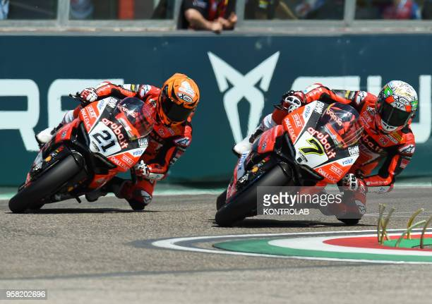 English Chaz Davies of Ducati Panigale R of Arubait Racing Ducati Team challenge with Italian teammate Michele Rinaldi during the Race 2 of Superbike...