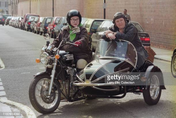 English chefs and television presenters Jennifer Paterson on left and Clarissa Dickson Wright pictured together on a motorcycle and sidecar as they...