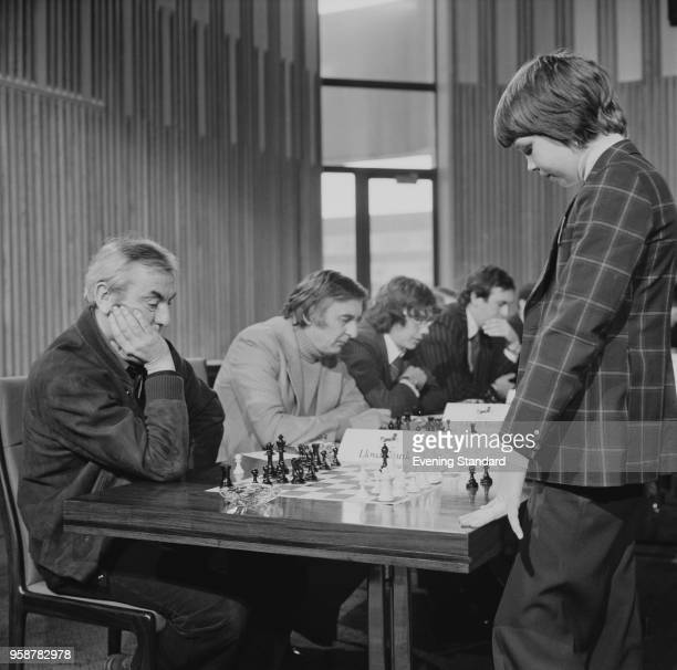 English chess grandmaster Nigel Short playing chess with English journalist Angus McGill at a tournament UK 21st February 1978