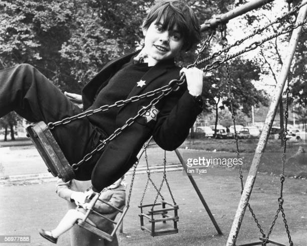 English child actor Jack Wild on a swing in his local park during a lunch break from the Speak Stage School October 1968
