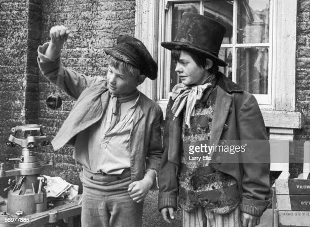 English child actor Jack Wild plays yoyo with Mark Lester his costar in the Carol Reed musical 'Oliver' November 1967 Lester plays Oliver Twist in...