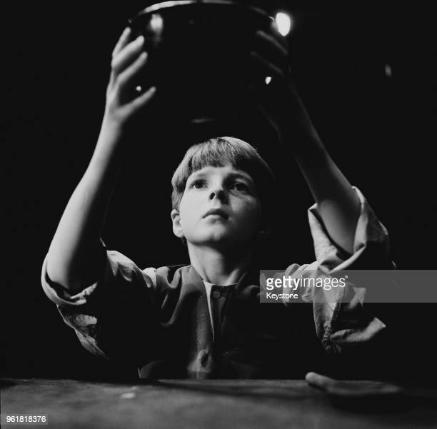English child actor Martin Stephens asks for more during a rehearsal for Lionel Bart's musical 'Oliver!', 4th August 1961. Stephens, who plays...