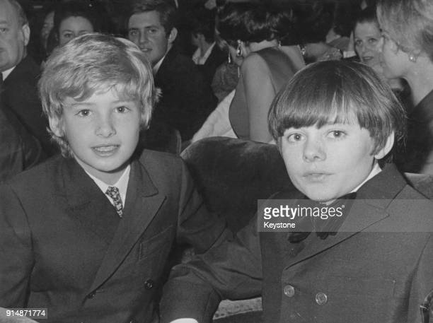 English child actors Mark Lester and Jack Wild attend a charity screening of the musical film 'Oliver' in aid of UNICEF France 6th December 1968 They...
