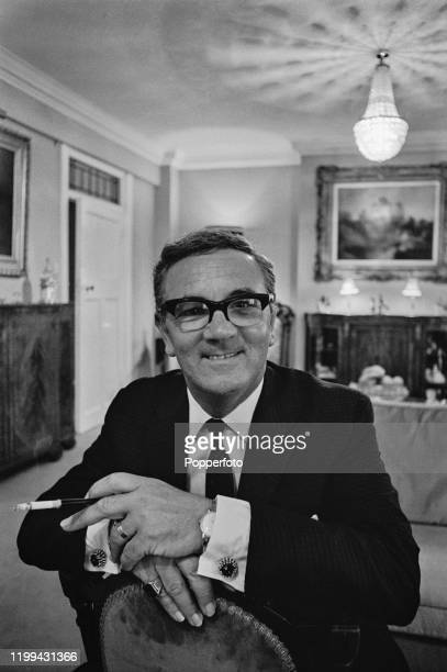English clairvoyant and astrologer Maurice Woodruff posed seated in a chair in August 1968