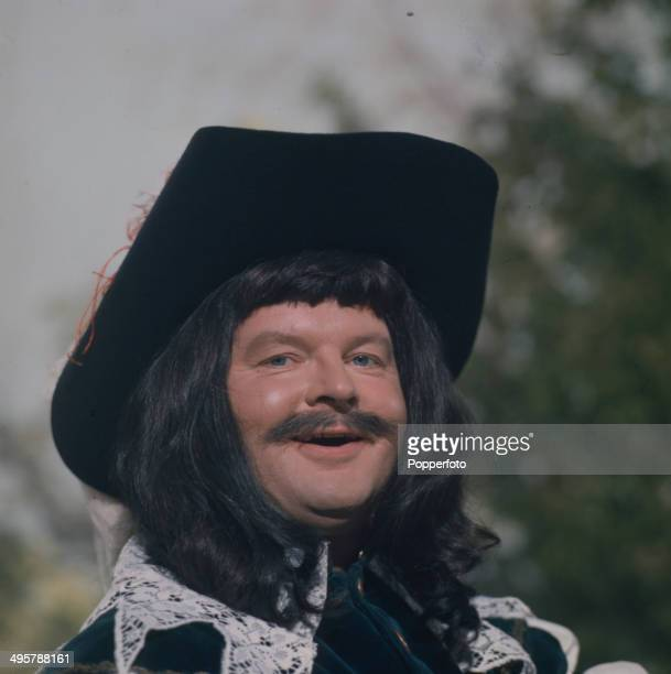 English comedian and actor Benny Hill posed in cavalier costume in a scene from his television series 'The Benny Hill Show' in 1968