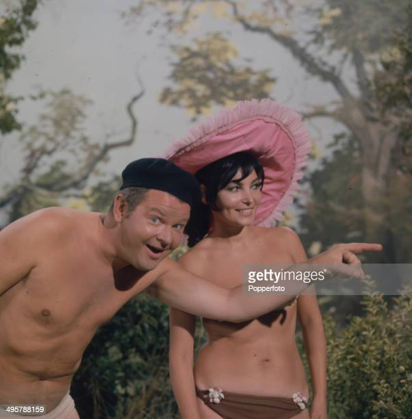 English comedian and actor Benny Hill posed in his underwear and beret with Belgian actress Bettina Le Beau in a scene from his television series...
