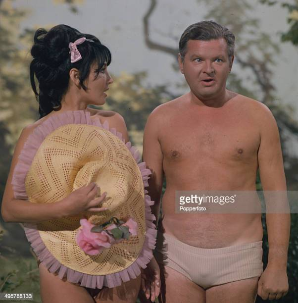 English comedian and actor Benny Hill posed in his underwear with Belgian actress Bettina Le Beau in a scene from his television series 'The Benny...