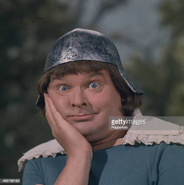 English comedian and actor Benny Hill posed in medieval costume in a scene from his television series 'The Benny Hill Show' in 1968