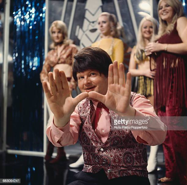 English comedian and actor Benny Hill posed on set in a television studio in London in 1971