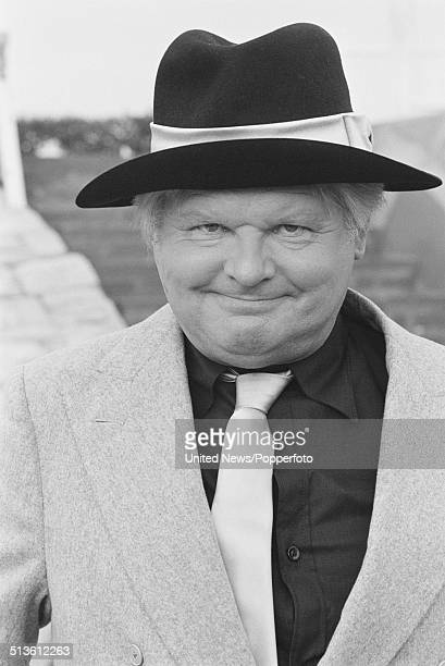English comedian and actor Benny Hill posed wearing a fedora hat in London on 14th September 1983