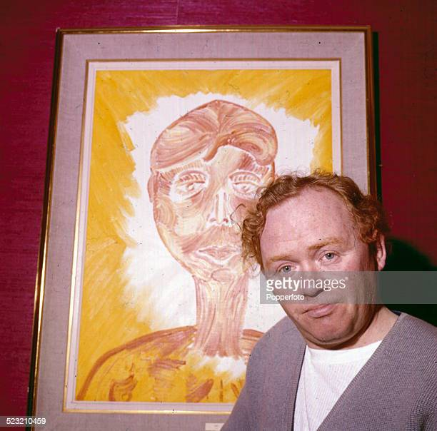 English comedian and actor Charlie Drake posed backstage at the Palladium in London during rehearsals for the musical The Man in the Moon in 1963