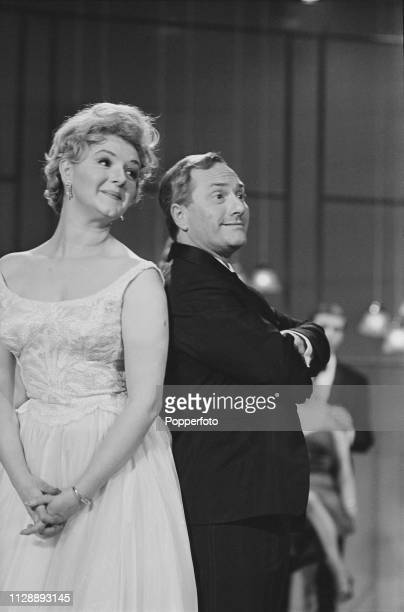English comedian and actor Dick Emery pictured together with actress Joan Sims during a recording of the BBC television series 'The Dick Emery Show'...