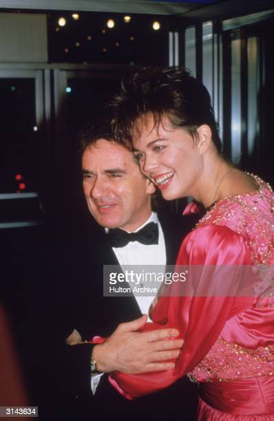 English comedian and actor Dudley Moore with his wife Brogan Lane at the premiere of his film 'Santa Claus The Movie'