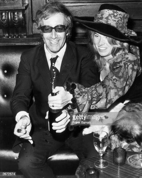 English comedian and actor Peter Sellers with his third wife Miranda Quarry at their wedding reception at 'Tramp' in Jermyn Street with Miranda's two...