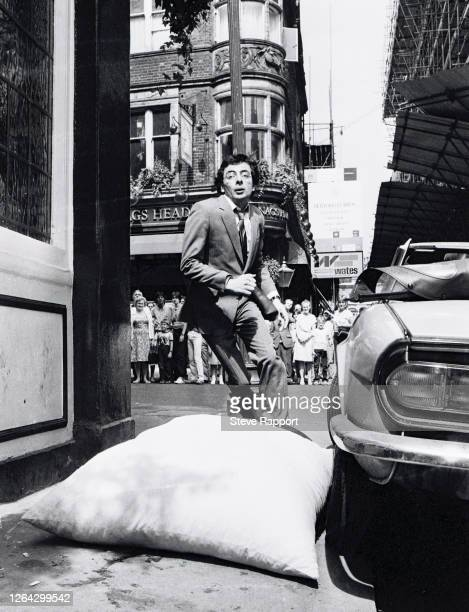 English comedian and actor Rowan Atkinson films 'Dead On Time' outside The White Lion on Floral Street , Covent Garden, London, 8/4/1981.