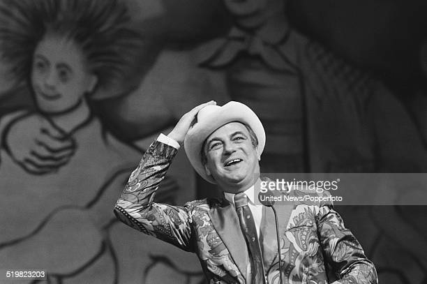 English comedian and actor Roy Hudd performs on stage at the Palladium in London during rehearsals prior to his performance on the Royal Variety Show...