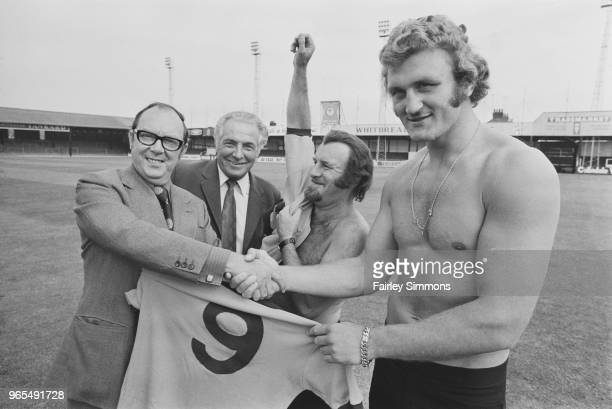 English comedian and director of Luton Town FC Eric Morecambe pictured on left shaking hands with heavyweight boxer Joe Bugner as Luton Town manager...