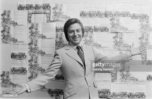 English comedian and singer Des O'Connor with a wall of greetings telegrams, UK, 6th December 1972.