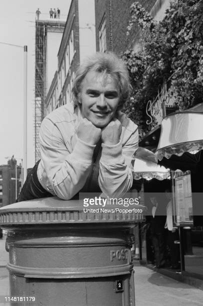 English comedian and singer Freddie Starr leaning on a pillar box London 17th March 1983