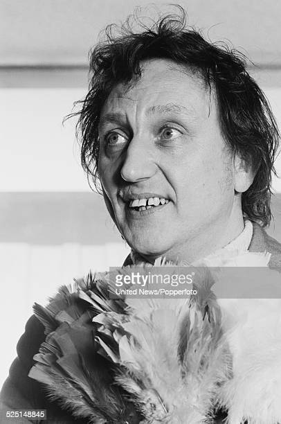 English comedian and singer Ken Dodd pictured holding a feather duster or tickle stick in London on 16th November 1978