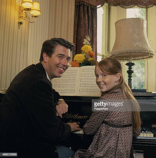 English comedian and television host Leslie Crowther posed at home with his daughter actress Liz Crowther in 1967
