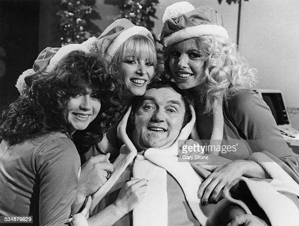 English comedian and writer Les Dawson and his glamorous assistants Ruth Burnett Lindy Benson and Monica Teama in santa costumes for Dawson's...