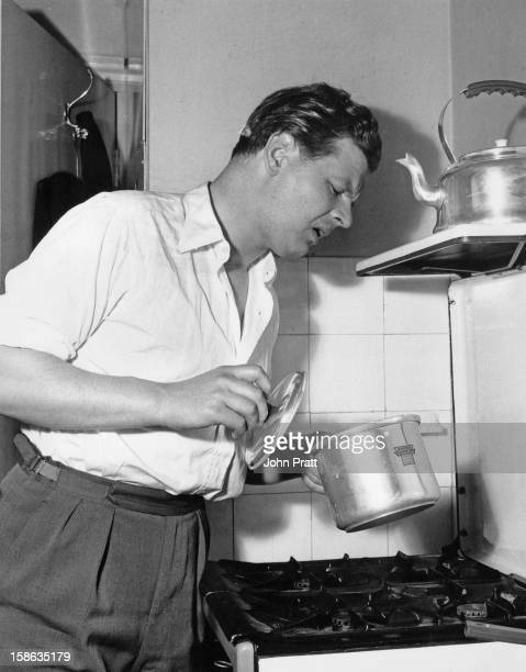 English comedian Benny Hill in the kitchen at his new flat in Maida Vale London 15th August 1955 He is currently appearing in 'Paris By Night' at the...