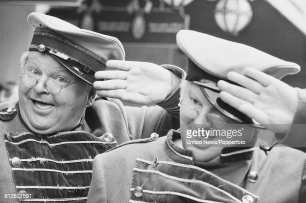 English comedian Benny Hill pictured in character as Fred Scuttle with his waxwork outside Madame Tussauds in London on 22nd May 1986