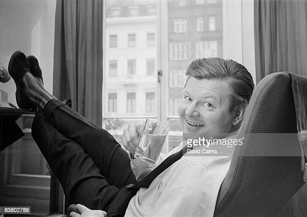 English comedian Benny Hill with his feet up at home 24th April 1965
