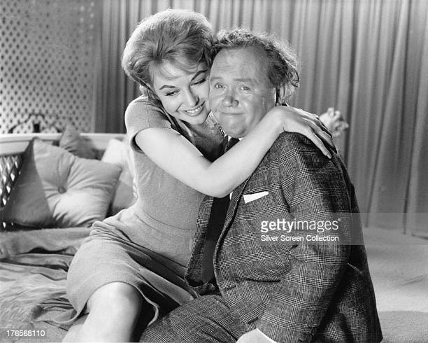 English comedian Charlie Drake as Ernest Wright and English actress Nyree Dawn Porter as Muriel in 'The Cracksman' directed by Peter Graham Scott 1963