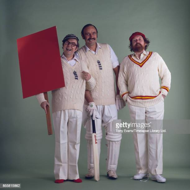 English comedian Eric Morecambe cartoonist and satirist Willie Rushton and cricketer Fred Rumsey during a photo shoot for the cover of the book 'The...