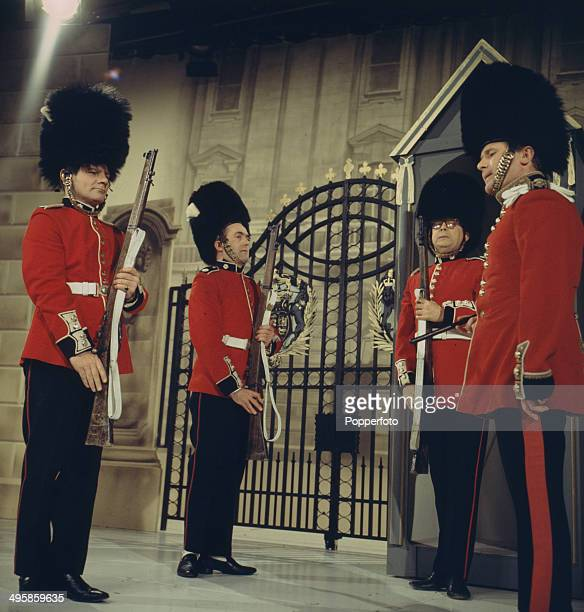 English comedian Eric Morecambe pictured with the writers Dick Hills and Sid Green all dressed as guardsmen in a sketch from the television series...