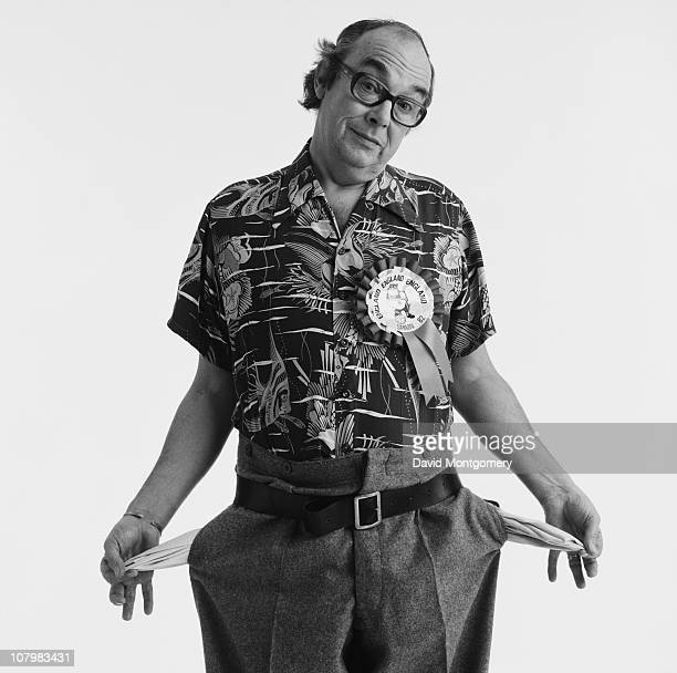 English comedian Eric Morecambe showing his empty pockets 8th February 1982 He is wearing a Bulldog Bobby badge from the Spain World Cup