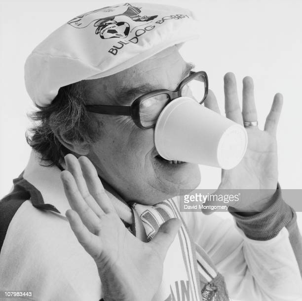 English comedian Eric Morecambe wearing a Bulldog Bobby cap for the FIFA World Cup 8th February 1982